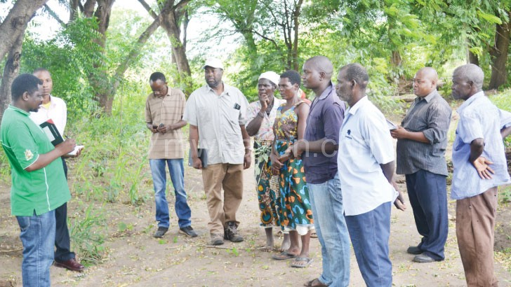 Chiotha (4th L) with some communities during the visit in Nsanje