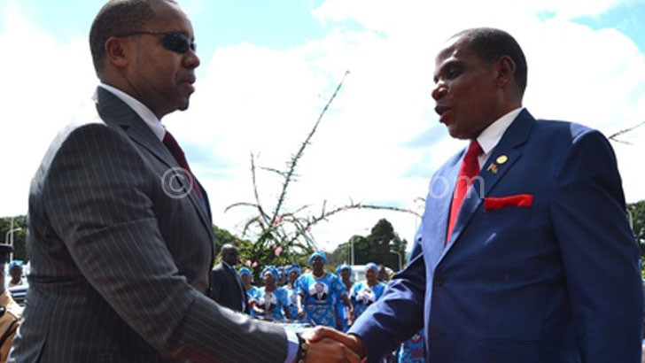 Chilima (L) being welcomed by Minister of Industry and Trade Joseph Mwanamvekha