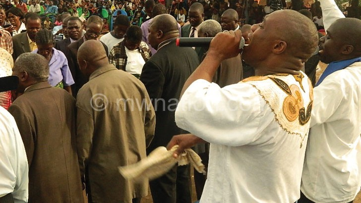 Apostle Lumwira (R) leads the clergy in praying for the country and its leadership