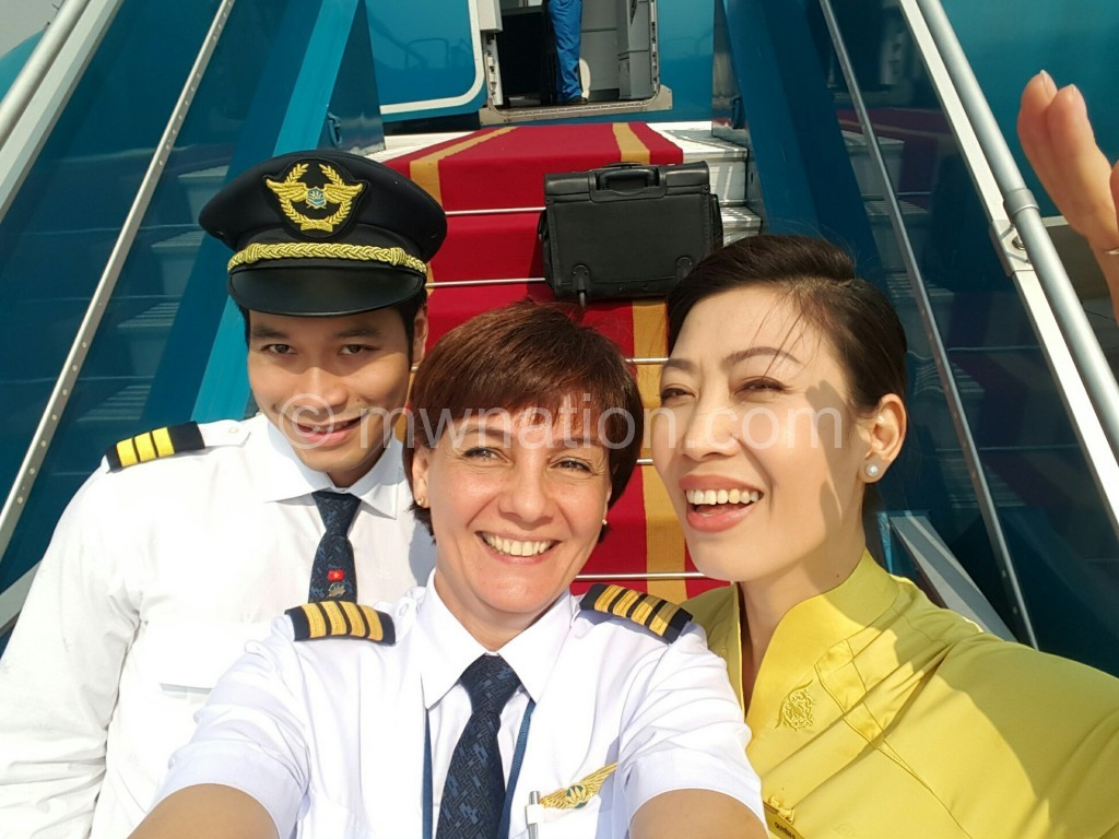 Foy (C) with colleagues at Vietnam Airlines