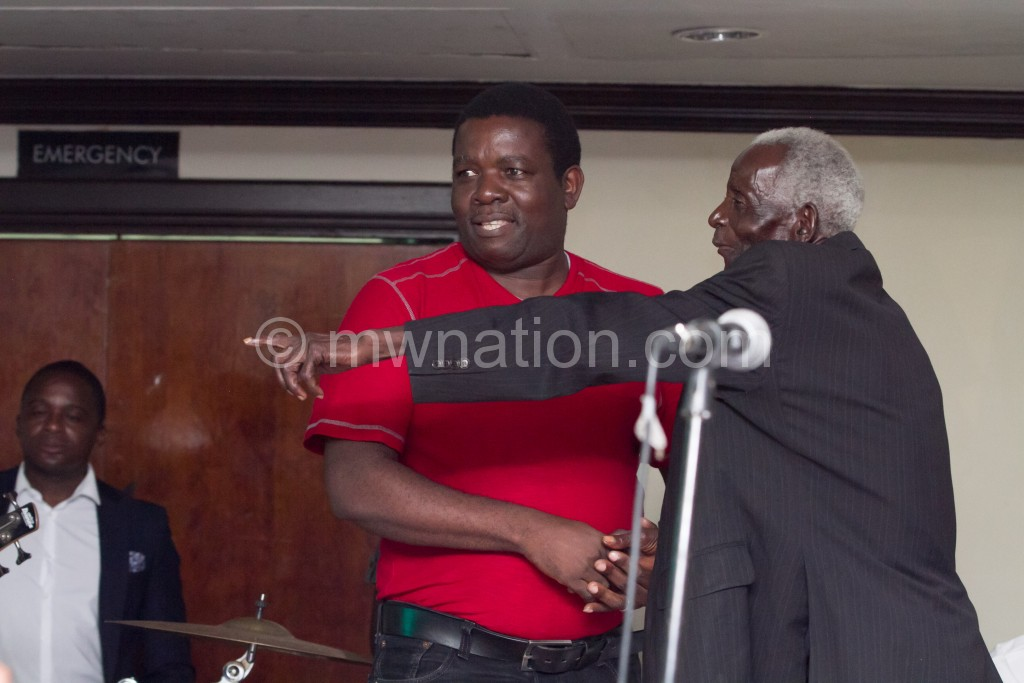 Chalamanda (R) gestures as Chilewe looks on during the Blantyre event
