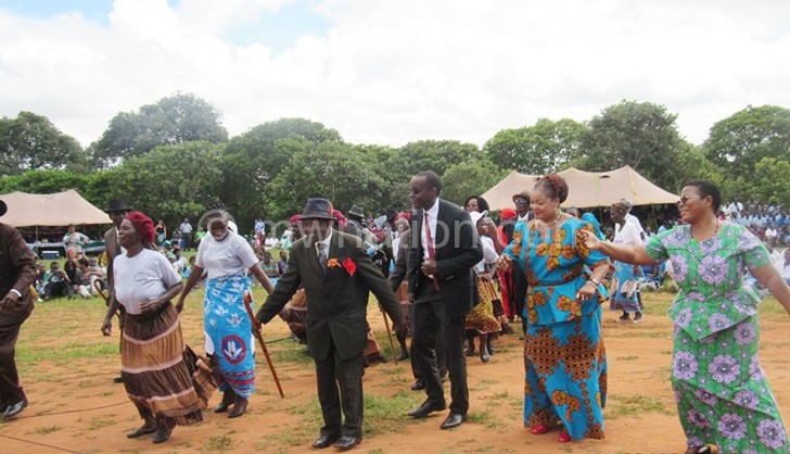 Kaliati (2nd R) joins the Honala dance with her principal secretary Mary Shaba (R) and others