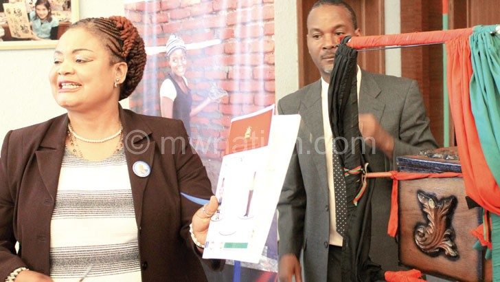Kaliati shows off a copy of the plan after the launch