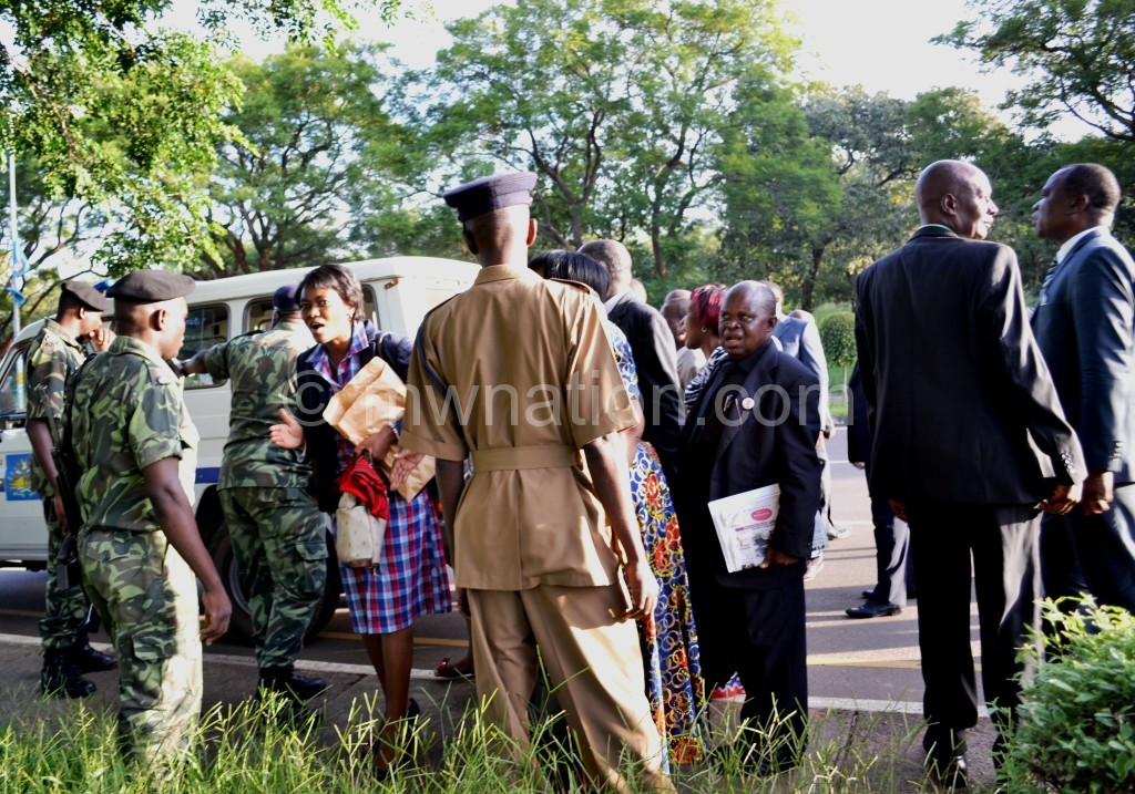 MPs asking police officers to remove a roadblock mounted within Parliament Building premises the day some MPs were arrested