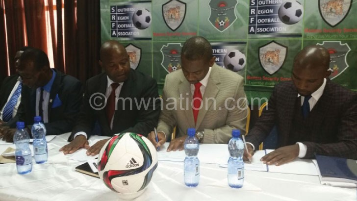 Nyamilandu (C) signing a sponsorship  agreement with Masters Security