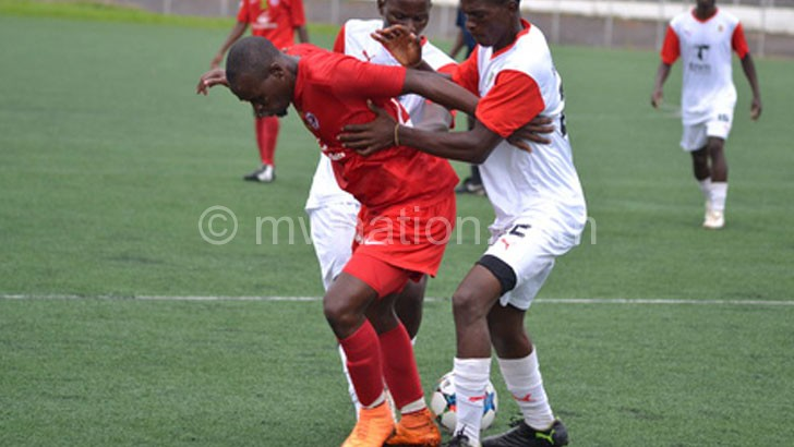 Settling down: Sulumba (R) scored a hat-trick