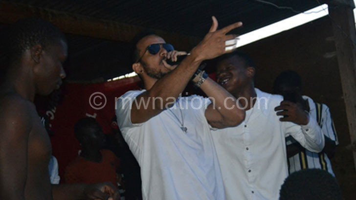 Patrons mob Theo as he performs during the show