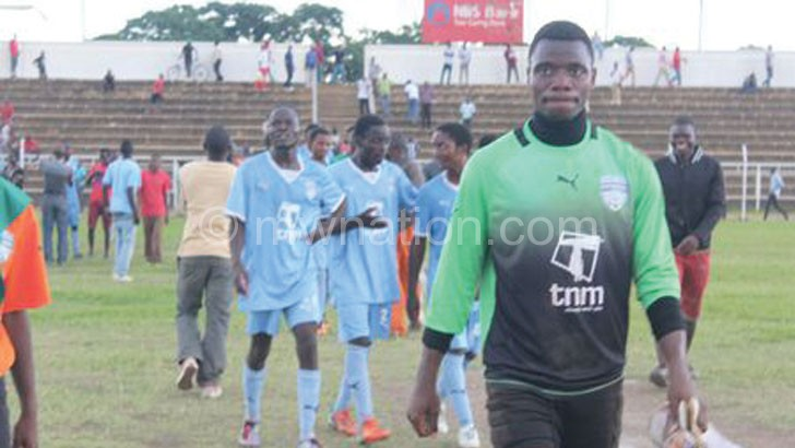 Wizards players walk off Civo Stadium pitch after Dedza Young Soccer Saints injunction