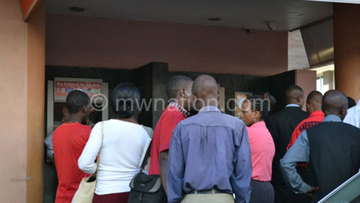 Malawians continue to endure long queues at ATMs