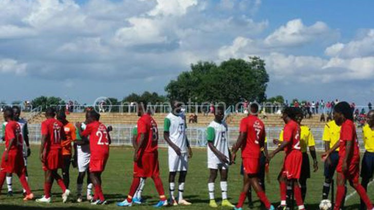 Bullets players (in red) greeting their Mafco counterparts before the match