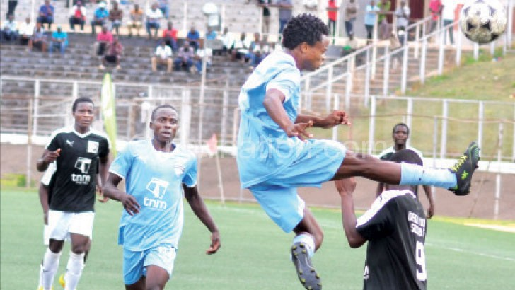 Dedza Young Soccer (in black) taking on Wizards