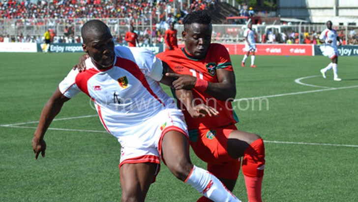 Out-muscled: Gabadinho Mhango (R) had a bad day in office