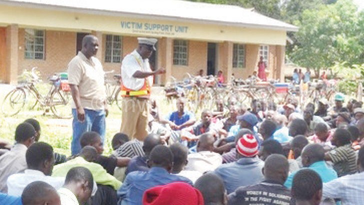 Phiri (standing R) addressing  the bicycle operators