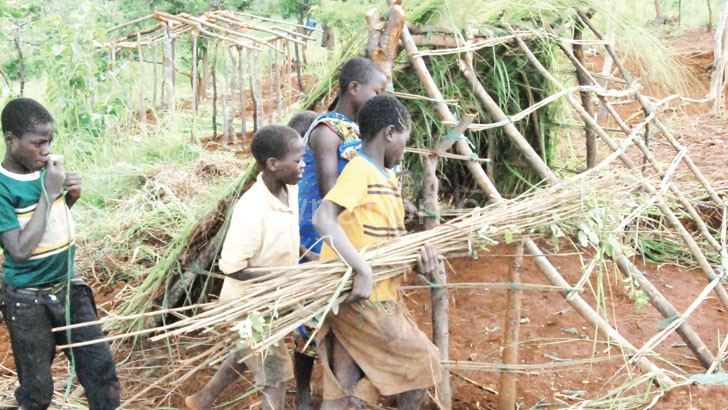 Children putting up a structure at Kapise Refugee Camp in Mwanza last week