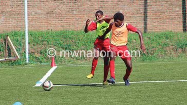 Fodya (R) has resumed training after recovering from Malaria