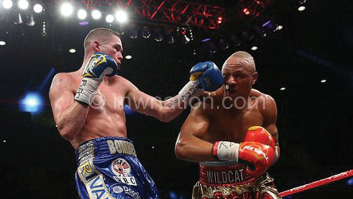 Chilemba (R) taking on Tony Bellew