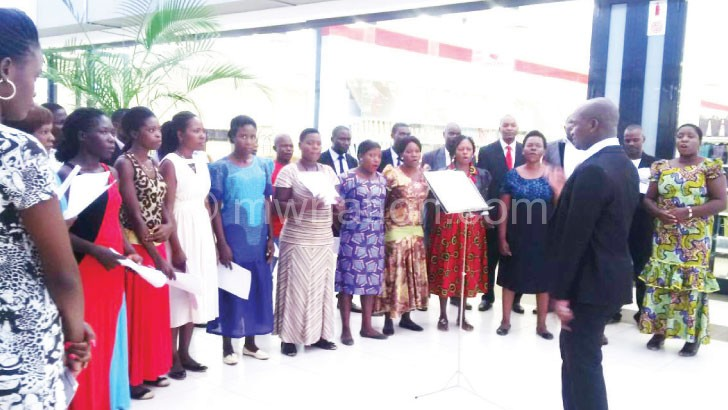 Lilongwe Community Choir hum an Easter tune at the Mpico  Shopping Mall in Lilongwe
