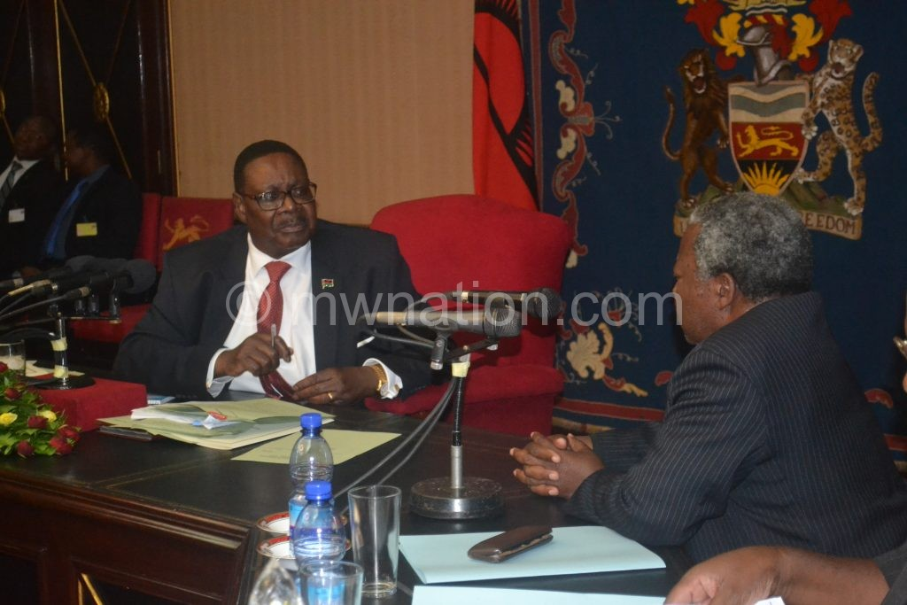 Mutharika and some PAC members in an earlier meeting
