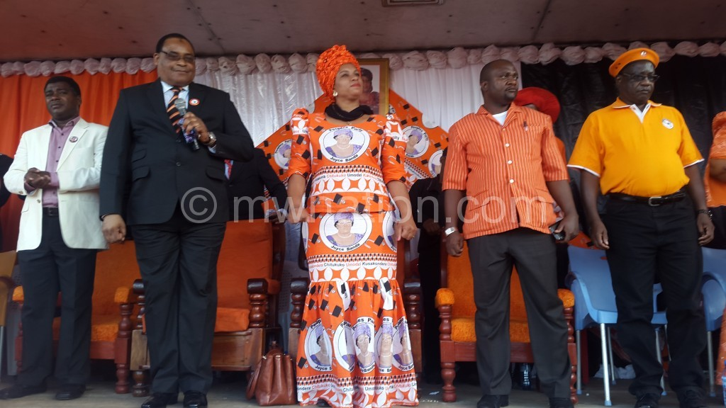 Mussa introduces his spouse, Matola (2nd from R) and a Mr Kumpukwe at the rally yesterday
