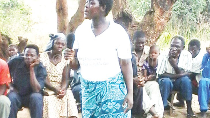 Villagers discuss women empowerment at a community gathering