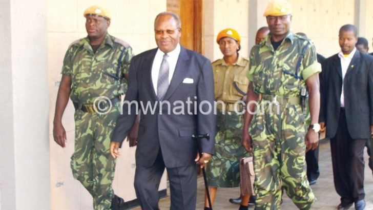 Muluzi and aides during an earlier court appearance