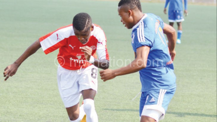 Bullets' Dalitso Sailesi (L) tries to beat Nomads' Stanley Sanudi  in a previous encounter