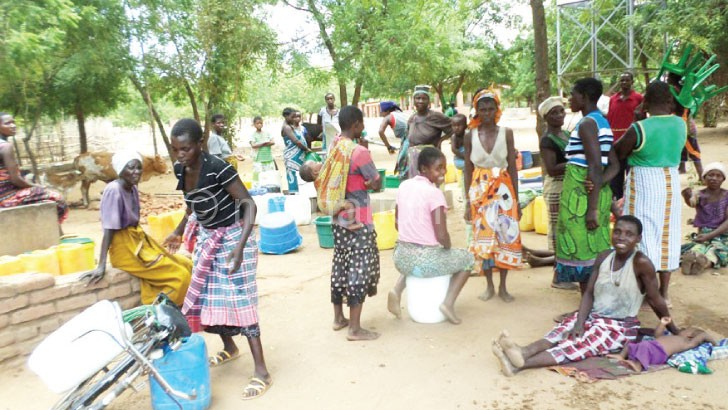 Women of Nsamba endure long hours at a borehole in Makoka in search for water
