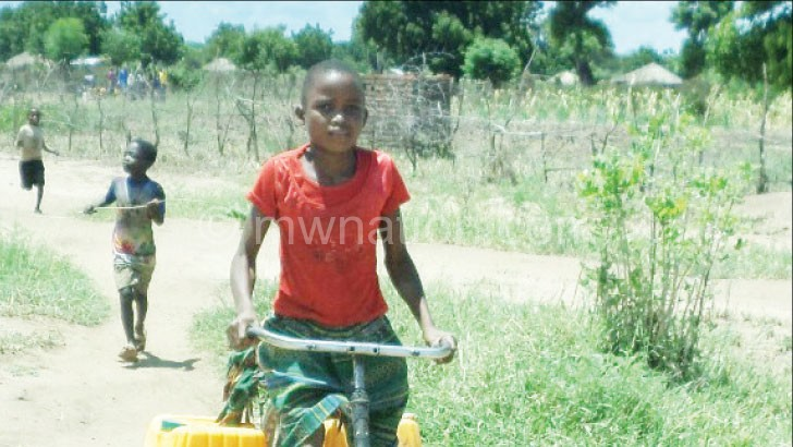Bridget cycles 2km daily to fetch water