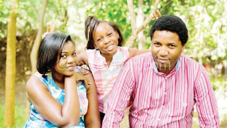 The Kawales relaxing with  their daughter, Atikonda Kay