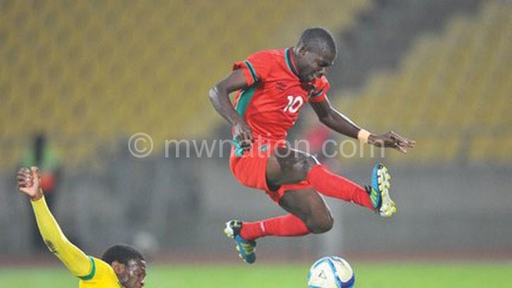 Flames midfielder John CJ Banda (R) avoids a tackle during the 2015 Cosafa Cup