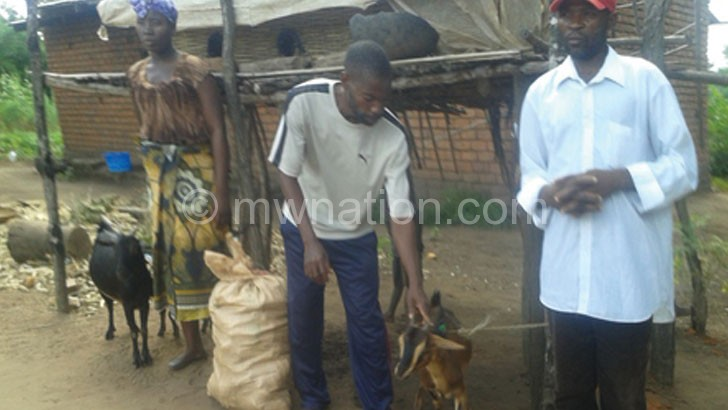 Some of the beneficiaries with their goats