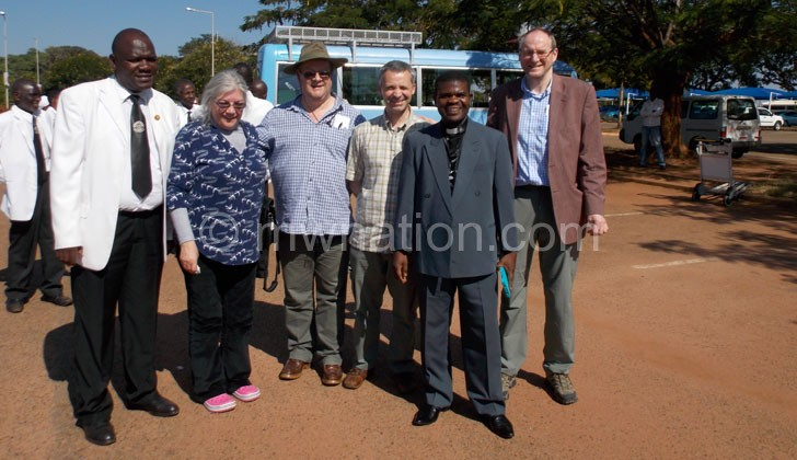 The Mid-Argyll delegation upon their arrival pose with Parish Minister Rev Kapombe Mwale (2nd Right)