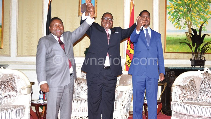 United we stand: Mutharika holds hands with Nyusi (L) and Lungu (R)
