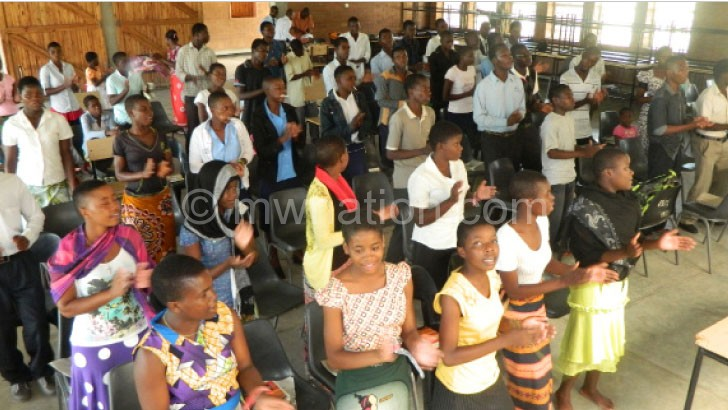 Students singing choruses on the day
