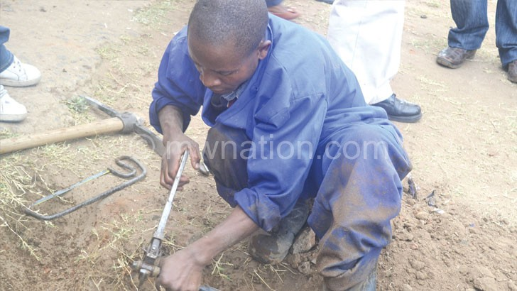 A BWB technician removing pipes during a crackdown on illegal connections