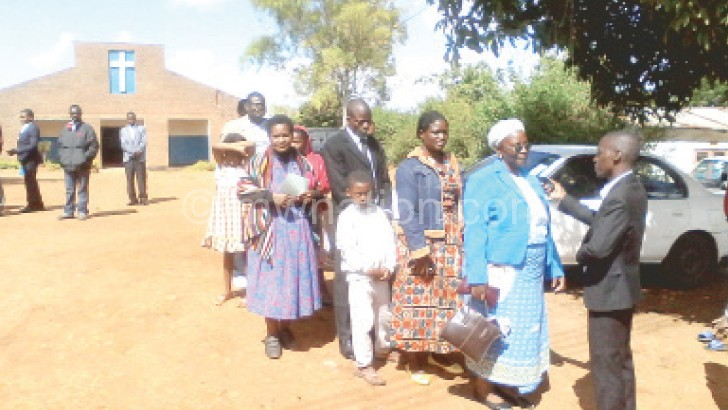 Zulu (R) offers Radio Maria-Malawi well-wishers at Namiyango  Catholic Church opportunity to greet relatives and friends