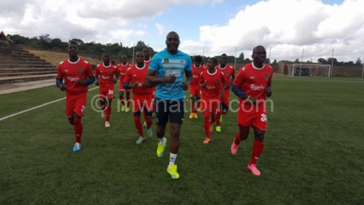 In suspense: Team manager Clement Kafwafwa leads the Flames warm-up yesterday