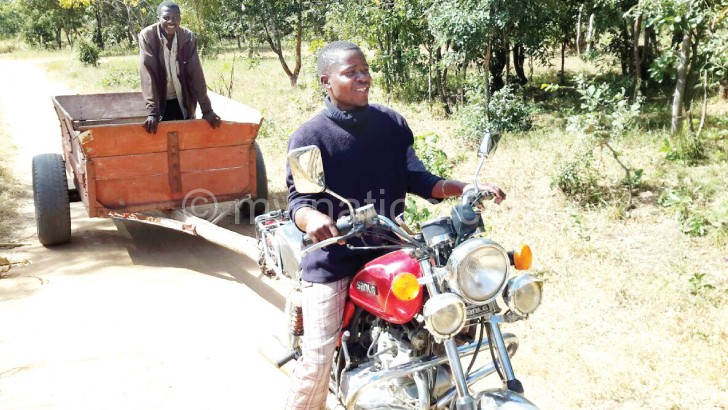 Phiri captured pulling one of the carts using his motorcycle