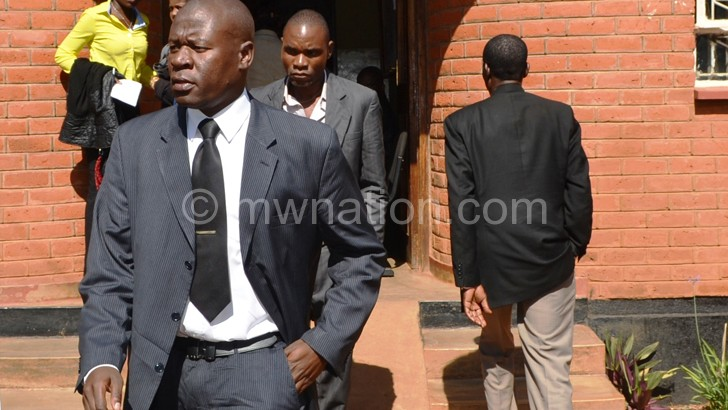 Kumwembe leaves court during an earlier appearance