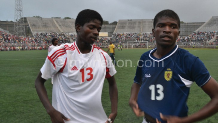 Then Griffin Youngsters' Mark Fodya (L), now with Silver, exchanges a jersey with his brother, Bullets' Yamikani after 2013 Presidential Cup match
