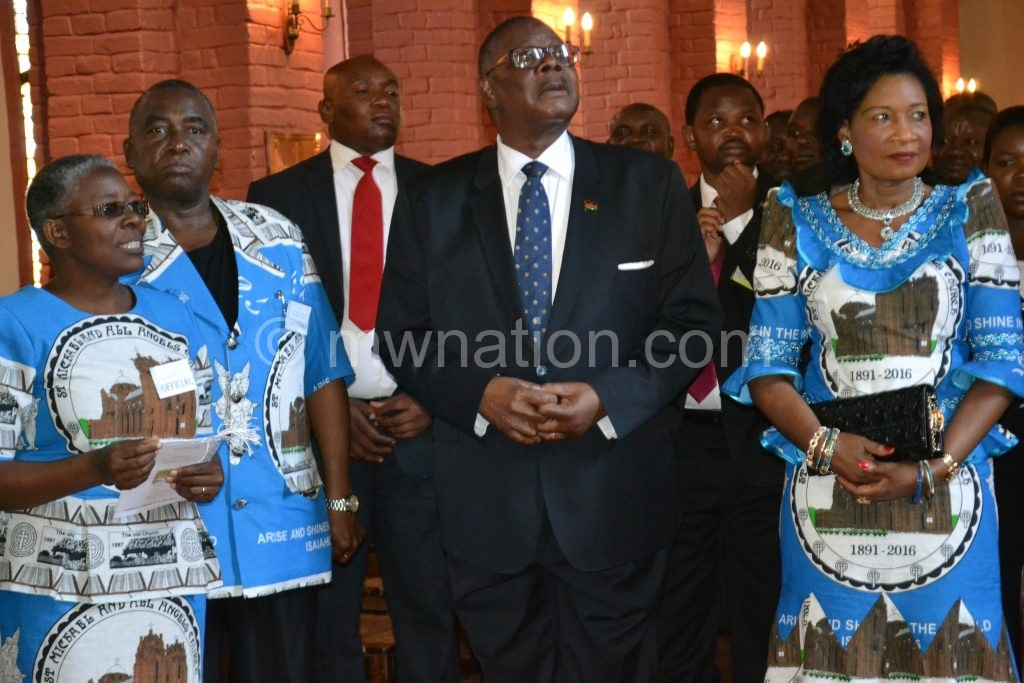Mutharika being briefed on the history of the church by Pauline Ntonga