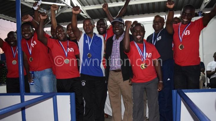 Kawawa (in cap) poses with the winners