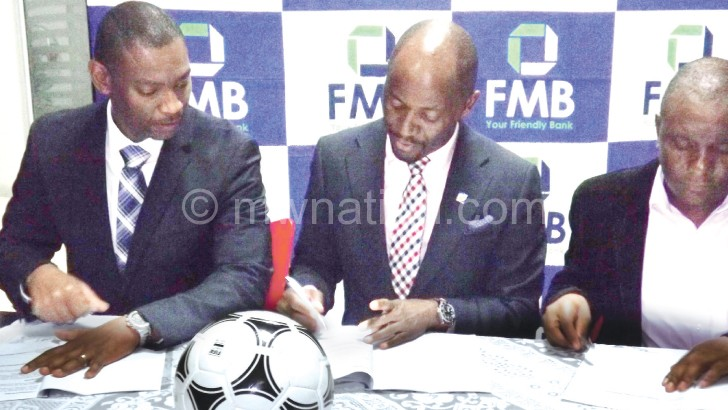 Done deal: Nyamilandu (L), Madinga (C) and NYFA chairperson Mavuto Missi