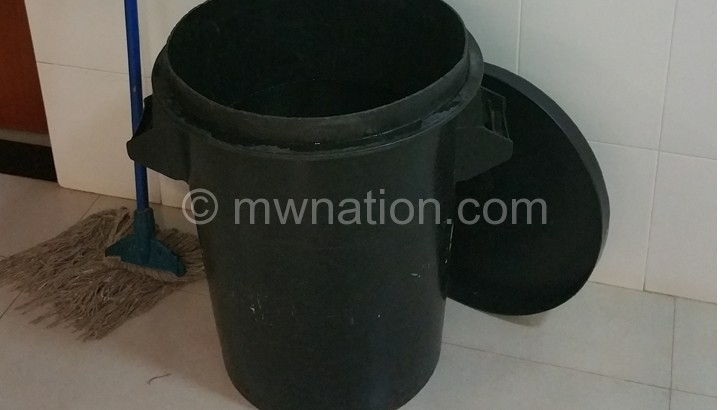 An empty bucket in a Parliament rest room
