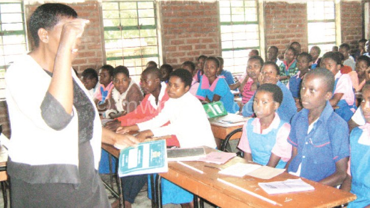 Teachers like the one in the picture are most affected by the headcount