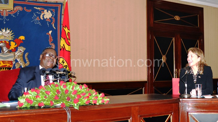 Mutharika shares a lighter moment with Hyde