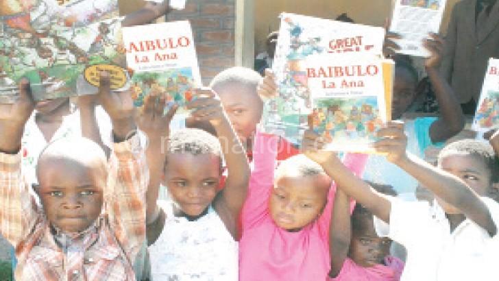 Children show off their Bibles