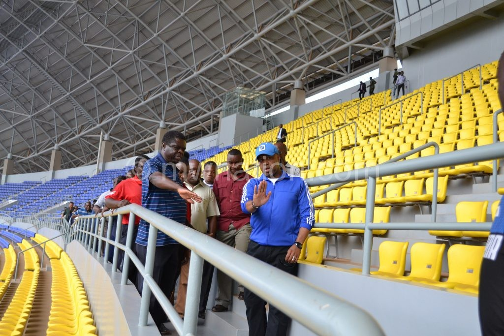 Chilima (R) being briefed on some of the facilities at the stadium by chief architect in the Ministry of Transport and Public Works Knight Munthali (L)