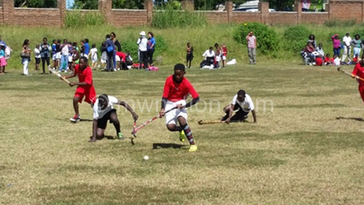 Hockey launch match between Scorpions Academy (in red) and Imperial Primary