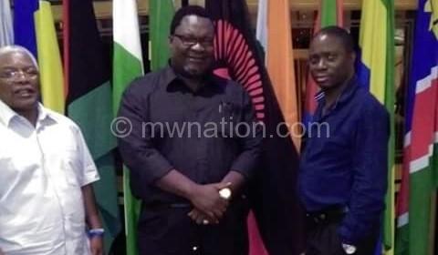 Lucius (C) at ECG with Kasambara (R) and Mpinganjira